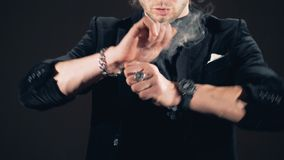 Slow motion footage of illusionist`s hands producing smoke. 4K stock video footage
