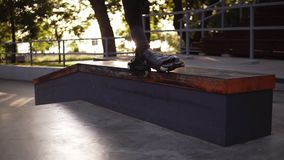 Slow motion footage of a skates roller extreme trick feet while skating on railings. Active teenager shot in the air in. Roller skate sin a skate park. Green stock footage