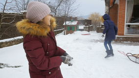 Slow motion footage of two girls having snow ball fight. Slow motion of two girls having snow ball fight stock footage
