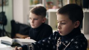 Slow motion footage of two little boys sitting in front of their laptops. Programming class. Alternative education for. Children stock video