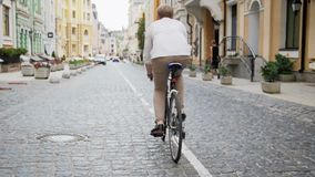 Slow motion footage of young man commuting to work on vintage sport bicycle stock video footage