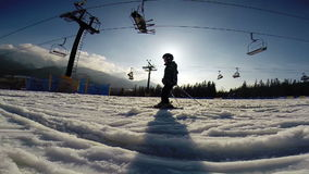 Slow motion footage: Young skier - first steps. stock video footage