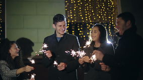 SLOW MOTION: Friends with sparklers dancing stock footage
