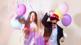 Slow motion of funny crazy couple having awesome time dancing. Funny crazy couple having awesome time dancing in party photo booth, graded in slow motion stock footage