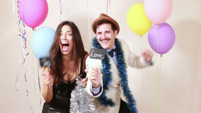 Slow motion of funny crazy couple in love having fun in photo booth stock video footage