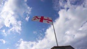 Slow Motion Georgian Waving Flag. On Flagpole with Blue Sky Background stock footage