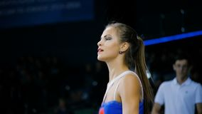 Slow motion girl cheerleader with long ponytail dances by fans on tribune. KAZAN, TATARSTAN RUSSIA - JUNE 28 2018: Slow motion smart slim girl cheerleader with stock video