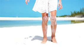 SLOW MOTION CLOSE UP: Girl playing with beautiful white sand at tropical beach stock footage