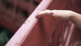 A girls touch wood. Slow motion of a girls touch wood stock footage