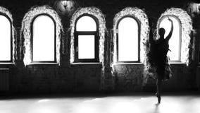 Slow motion graceful ballerina dancing in studio. Pretty ballet woman having rehearsal. Monochrome style stock footage