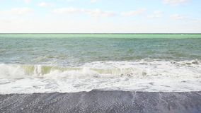 Slow motion striped sea after a storm under a pale sky. Slow motion green-gray striped sea after a storm with waves under a pale sky with clouds stock video footage