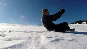 Slow motion of a guy turn a somersault in the snow. Tumbling man having fun stock video footage