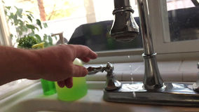 Slow Motion of Hand Turning Off Dripping Kitchen Faucet stock footage