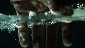 Slow Motion Hand Underwater stock footage