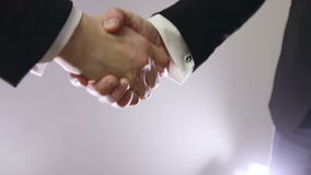 Slow motion. Handshake of business partners. Bright light in the background stock video