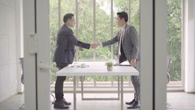 Slow motion - Handshake to seal a deal after a job recruitment meeting. stock video