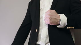 Slow motion. Handshake of two men in suits. White background stock footage