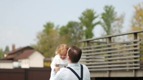 Slow Motion Of Handsome Father Throwing His Adorable Daughter In The Air. stock footage
