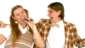 In slow motion happy geeky hipsters singing with microphone stock video footage