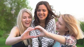 Slow motion. Happy and girlfriend spend time together. Girl making heart hands. Happy and girlfriend spend time together. Girl making heart hands stock video footage