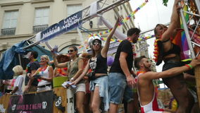 Slow motion of happy people at gay parade stock video