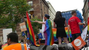 Slow motion of happy people at gay parade stock footage