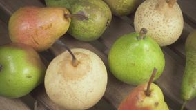 Slow motion harvest of pears on a wooden table. Slow motion harvest pears on a wooden table and half a pear camera moves over stock footage