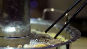 Slow Motion of traditional Beijing hot pot with a donut-shaped brass pot. stock video