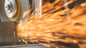 Slow motion: Industrial grinder in action. A lot of sparks.