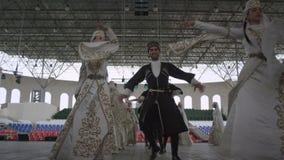 Slow Motion of Ingushetia Folk Ensemble Dancing Men Women stock video