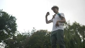 Slow motion of kendama master player swirling toy in air showing a complicated trick in the park - stock video footage