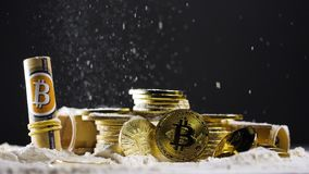Powder falls on coins created as bitcoin currency