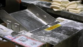 Slow Motion man hands prepairing dough of dumpling in a industrial machine. Slow Motion of man hands cook and prepairing dough of dumpling in a industrial stock footage