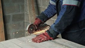 Slow motion man`s hands cuts metal with a circular saw, sparks fly to the side. Slow motion man`s hands cuts metal with a circular saw, sparks fly to the side stock footage