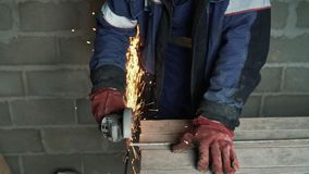 Slow motion man`s hands cuts metal with a circular saw, sparks fly to the side. Slow motion man`s hands cuts metal with a circular saw, sparks fly to the side stock video