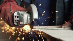Slow motion man`s hands cuts metal with a circular saw, sparks fly to the side. Slow motion man`s hands cuts metal with a circular saw, sparks fly to the side stock video footage