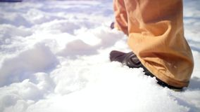 Slow motion of Man trekking in snow, sunny winter stock footage