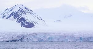Slow motion of a massive glacier in the cold arctic stock video footage