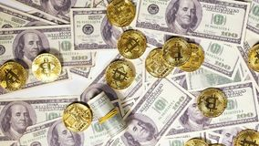 Slow Motion Golden Coins Created by Bitcoin Fall on Banknotes stock footage