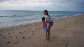 Slow motion mother and little daughter rejoicing at arrival to seaside stock video