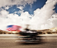 Slow motion on motorbike. Blur movement on bike rider, motorcycle road trip, summer US tour ride, people traveling on countryside highway, freedom lifestyle royalty free stock image