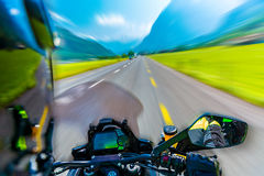 Slow motion of motorbike. Riding on the mountainous highway, extreme sport, touring along Alps, summer adventure, speed concept royalty free stock photography
