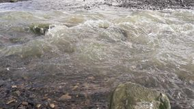 Slow Motion mountain stream close up. Super Slow Motion mountain stream beautifully flows close up stock video