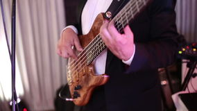 SLOW MOTION: Musician playing bass guitar stock video