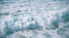 Slow motion Ocean Waves Breaking on Shore stock footage