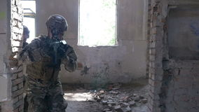 Slow motion of officer and his team advancing in abandoned building upper floor searching for a target stock footage