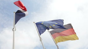 Slow motion over French, German and European Union Flag stock video