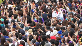 Slow Motion Pan of Large Crowd at Electronic Music Festival Tokyo Japan stock video footage