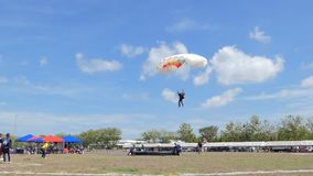 Slow Motion of Parachutist was landing in to the target, Accuracy Landing,. In during Thai Army Parachuting Competition 2019 on June 15, 2019 in Lopburi stock video footage