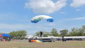 Slow Motion of Parachutist was landing in to the target, Accuracy Landing,. In during Thai Army Parachuting Competition 2019 on June 15, 2019 in Lopburi stock footage